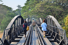 Travel Railway Metal Bridge Of World War History, River Kwai In Kanchanaburi At Thailand