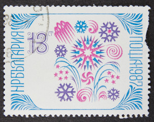 A stamp printed in Bulgaria, shows Sofia stamp exhibition emblem within folklore patterns in new year 1988 series, 1987