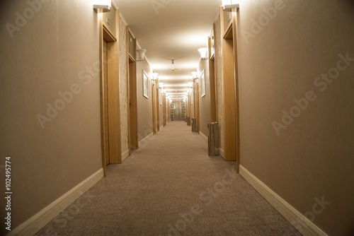 Fotografie, Tablou  Corridor with stairs into hotel