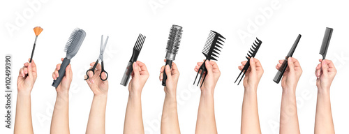 collection of hands holding tools for hair salon isolated on whi
