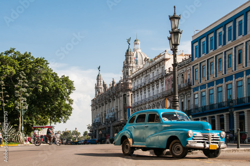 Old car in the square Canvas Print