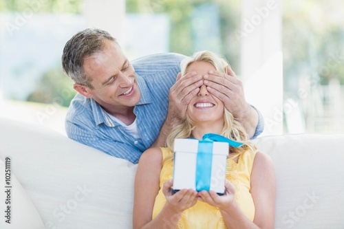 Fotografering  Husband surprising wife with a present