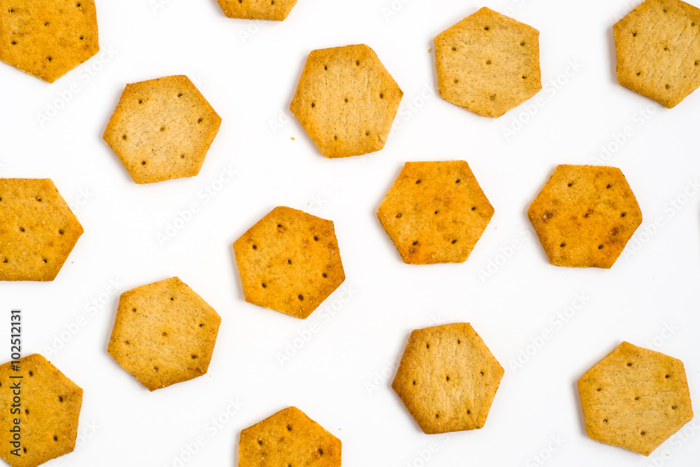 Fototapeta Yellow, hexagon crackers isolated on white background. Food texture.