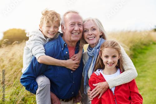 Obraz Grandparents With Children On Walk Through Countryside - fototapety do salonu