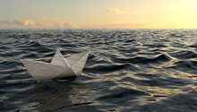 Origami Paper Boat Sailing On Blue Water