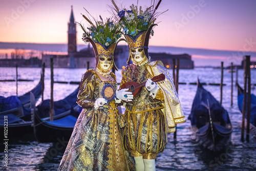 Costumed couple on the San Marco square during Carnival in Venic