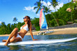 Travel Vacation. Beautiful Sexy Young Woman With Fit Body In White Bikini Relaxing On Stand Up Paddle ( Surfing ) Board In Sea Water On Tropical Resort. Healthy Lifestyle Concept. Summer Fun. Sports