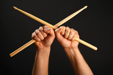Two Hands With Crossed Drumsti...