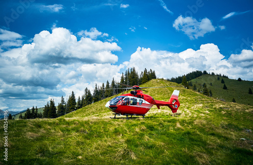plakat Helicopter takeoff in the mountains