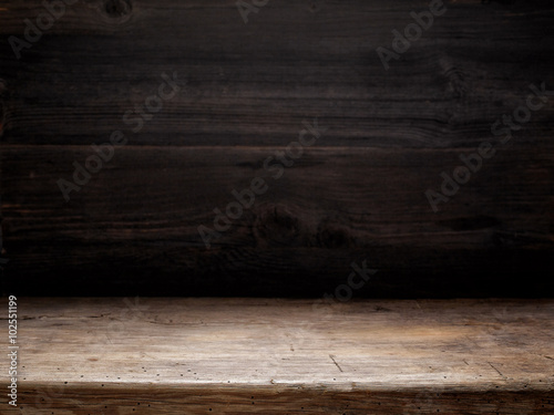 Foto op Plexiglas Hout wooden table and dark wooden wall
