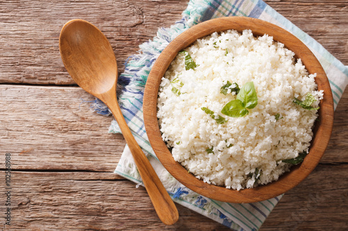 Cauliflower rice with basil in a bowl close-up Fototapeta
