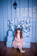 Studio photo of a beautiful girl sitting in a beautiful interior