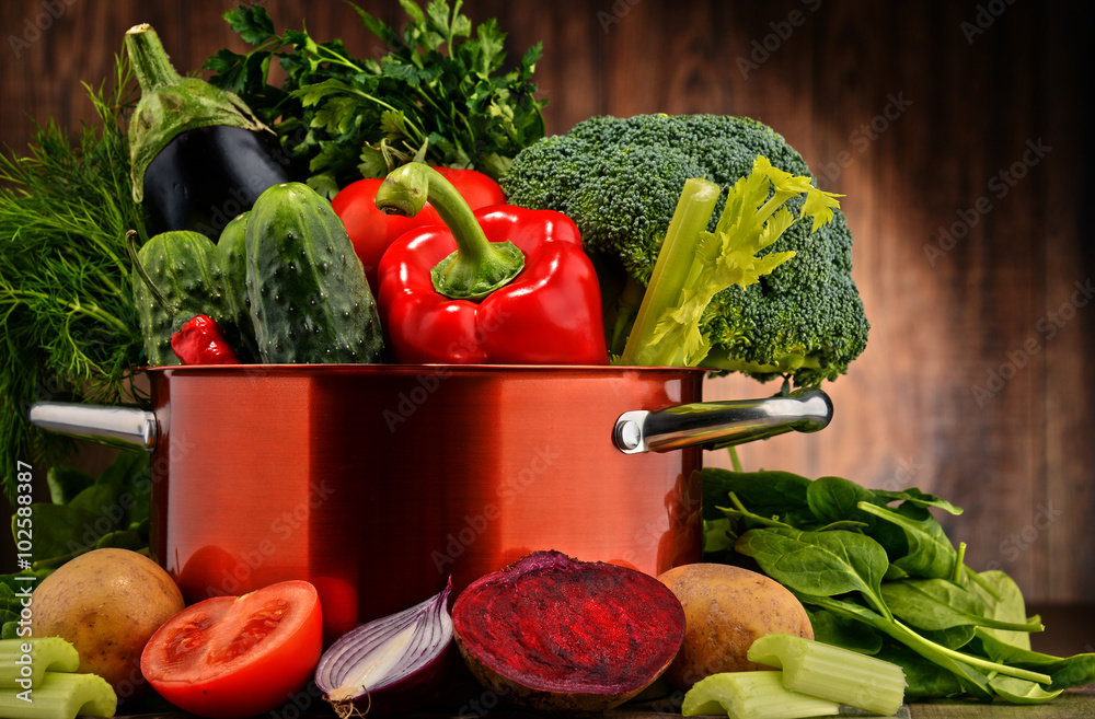 Composition with pot and raw vegetables