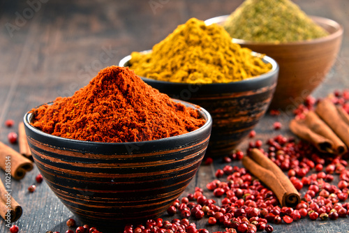 Photo  Variety of spices on kitchen table