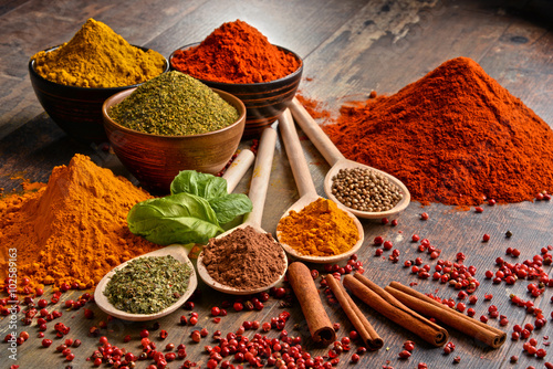 Fotografering  Variety of spices on kitchen table