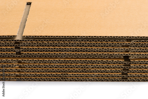 Foto  stack of corrugated cardboard boxes. side perspective view of fl