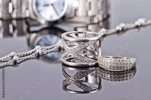 Elegant ring made of silver and silver chain and women's watches