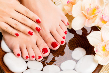 Fototapeta Beautiful female feet at spa salon on pedicure procedure