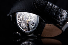 Metal Case Skeleton Watches With Blue Hands And Blue Sapphires On Leather Strap Back Side View