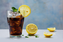 Glass Of Cola Or Coke With Ice Cubes, Lemon Slice And Peppermint
