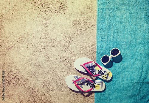 Top view of sandy beach with summer accessories and copy space