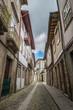 Facades and alleyway of Guimaraes, Portugal.