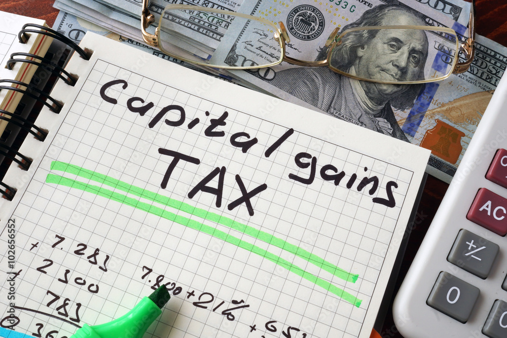 Fototapety, obrazy: Notebook with capital gains tax  sign on a table. Business concept.
