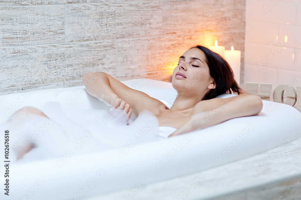 Fototapeta Beautiful woman relaxing in the bathroom