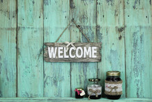 Welcome Sign Hanging Over Jars...