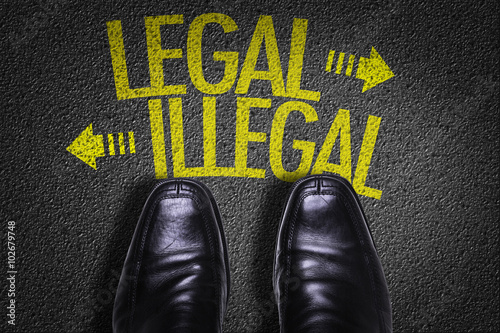 Photo  Top View of Business Shoes on the floor with the text: Legal - Illegal