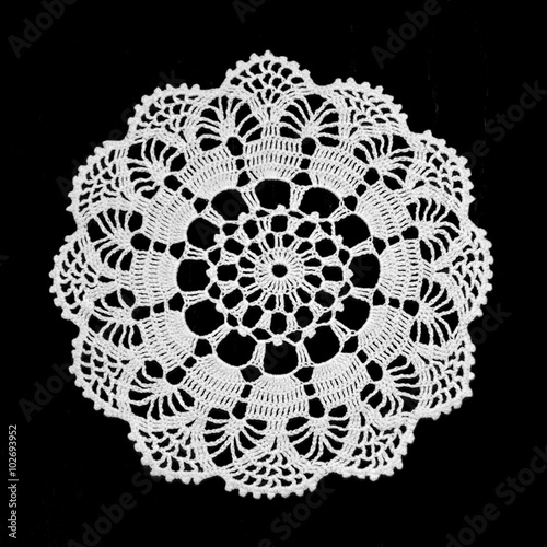 Fényképezés  Lace doily isolated on black background