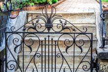 Antique Iron Gate In The Rain.