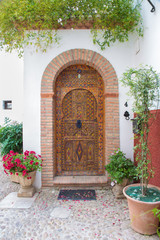 Fototapeta na wymiar Granada - The door of house in mudejar style.