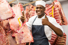 African Butcher Holding Meat