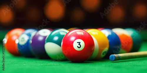 Obraz na płótnie Billiard balls in a green pool table