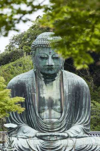 The Great Buddha (Daibutsu) on the grounds of Kotokuin Temple in Fototapeta