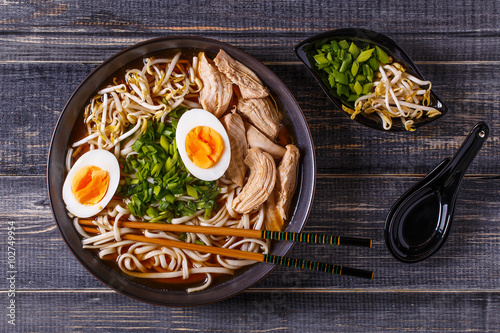 Obraz na plátne  Japanese ramen soup with chicken, egg, chives and sprout.