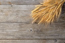 Wheat On The Wooden Background
