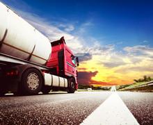 Semi Truck In Motion. Speeding Truck On The Highway
