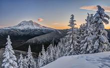 Morning Sunlight Illuminates Mt Rainier In Snowy Alpine Scene