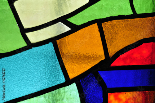 Fotografie, Obraz Image of a multicolored stained glass window with irregular bloc