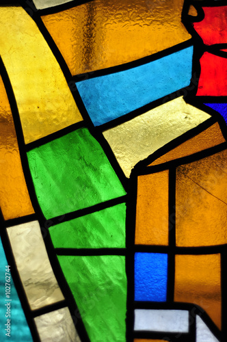 Photo  Image of a multicolored stained glass window with irregular bloc