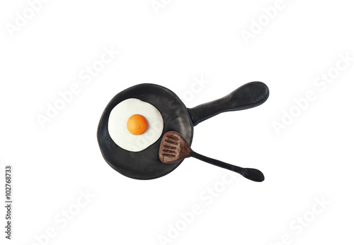 egg fried in black pan model from japanese clay on white background