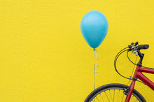 Red Bike With A Blue Balloon A...