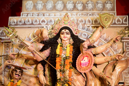 Fotografie, Obraz  MUMBAI, INDIA - October 20, 2015: An idol of revered goddess Durga standing in the temporary temple in the city of Mumbai during Durga Puja festival celebration