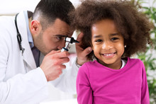 Smiling Little African Girl With Ear Specialist