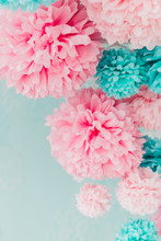 Blue And Pink Pom-poms On Background Brick Wall