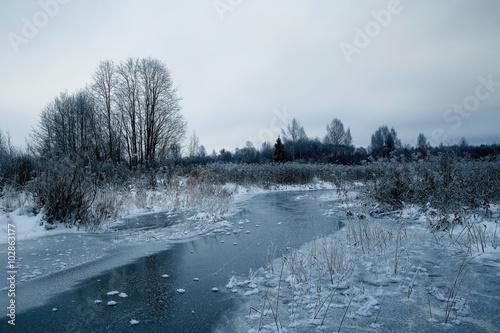 Fotobehang Bergen frozen creek in winter forest landscape