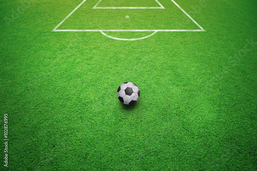 Conceptual football free kick soccer ball background. Soccer ball on sunny soccer field ground.