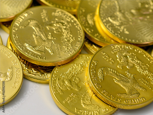 Fotografie, Obraz  Gold coins, a rare precious metal to geologists and chemists and a symbol of val